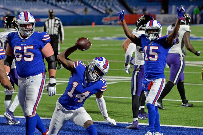 Bills receiver Stefon Diggs celebrates after scoring a touchdown against the Baltimore Ravens on Saturday.