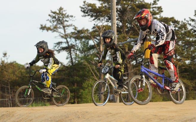 Riders make their way around the Cape Cod BMX track during a 2016 clinic at Joint Base Cape Cod  The crackdown in security over the past five years has made it difficult for families to get on the base, drastically reducing membership.