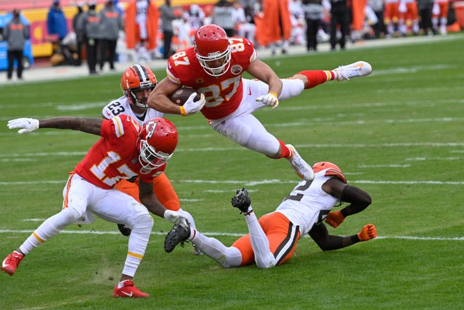 Kansas City Chiefs tight end Travis Kelce (87) leaps over Cleveland Browns safety Karl Joseph, right, during a 20-yard touchdown reception last Sunday in Kansas City.