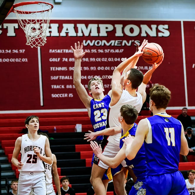 Despite a taller East Buchanan defender's attempt to stop the shot, 2020-21 Chillicothe (Mo..) HS basketball Hornet Hayden Simmer hits a tough inside shot to give the Hornets a 19-points lead late in the third period of Thursday's (Jan. 21) game in Chillicothe. Following Simmer's shot, East Buchanan turned red-hot, cutting the CHS lead to five in less than three minutes, but it never caught up and the Hornets won, 57-53. Simmer had a double-double of 14 points and 12 rebounds and also blocked two shots.