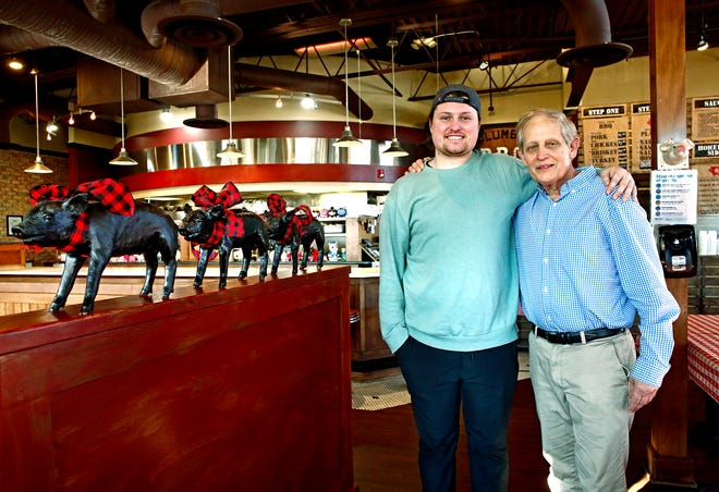 Kyle Turner, left, is taking over some of Hoggy's operations from his father, Mark Turner, right, who founded Hoggy's 30 years ago with Ken Smith.