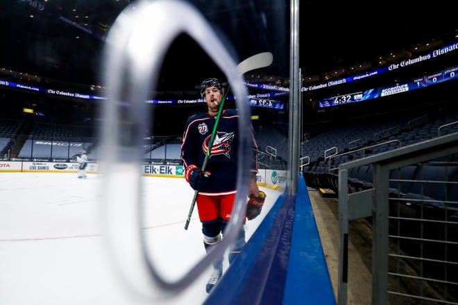 Pierre-Luc Dubois skates along the boards during a first-period stoppage in the Blue Jackets' game against Tampa Bay on Thursday.