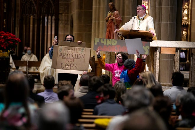 A small group of protesters disrupted the annual Respect Life Mass on Friday, Jan. 22, at St. Joseph Cathedral, presided over by Catholic Diocese of Columbus Bishop Robert Brennan.