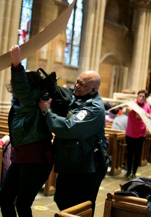 A small group of activists for reproduction freedom were charged after protesting at St. Joseph Cathedral during a Respect Life Mass in January.