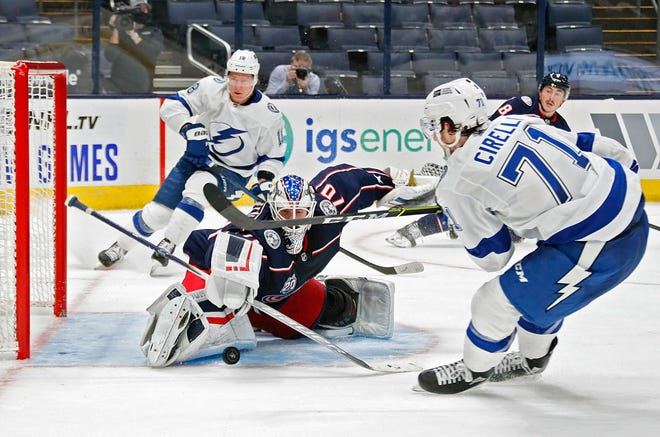 Joonas Korpisalo (70) makes a save against Lightning center Anthony Cirelli (71) in overtime Thursday night. It was one of his 34 saves in the game.