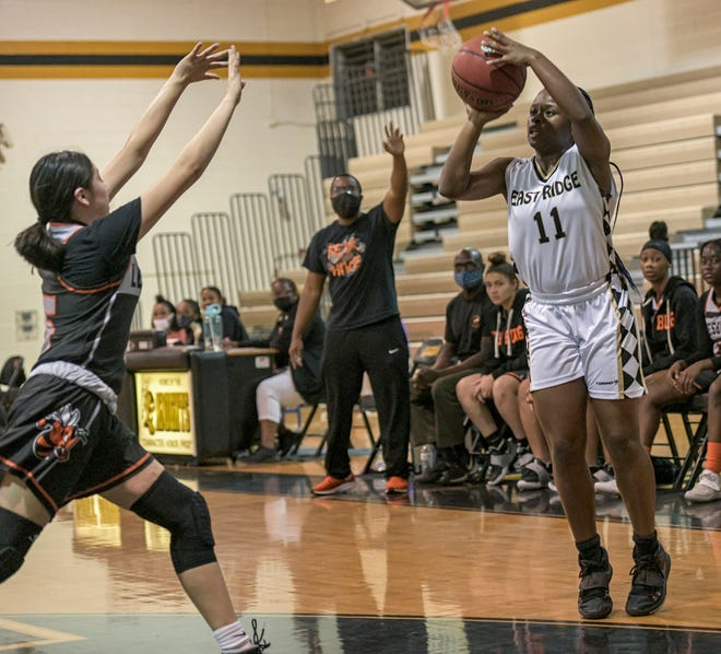 East Ridge's Hailey Hunt (11) makes a shot during Thursday's game against Leesburg in Clermont. Hunt scored 13 points to help the Knights to a 49-45 win.[PAUL RYAN / CORRESPONDENT]