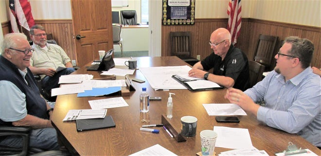 Emergency Management Director Gary Mellor (top right) and assistant Luke Hall (bottom right) pictured at a meeting last year, met with Holmes County Commissioners on Thursday to approve the County Hazard Mitigation Plan.