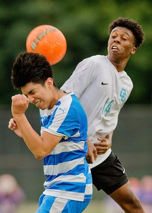 Lexington's Kevin Velasquez (left) and Oak Grove's A.J. Salandy compete to head the ball during their soccer match in 2019. Both were senior all-conference players. [Donnie Roberts/The Dispatch]