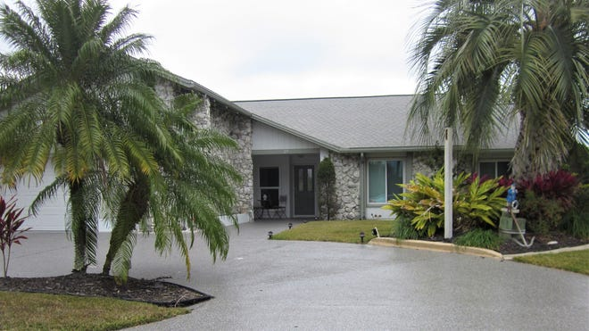 This house on Christopher Court sold recently for $525,000. It has three bedrooms and two baths in 2,371 square feet of living space. Built in 1993 on a saltwater canal, it also has fireplaces in the master bedroom and great room, a screened lanai, a pool and spa and a dock and boathouse.