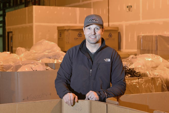 TechTank owner Brock Allen, 39, stands in the company's shipping warehouse in Millcreek Township.