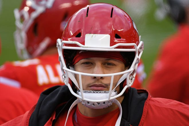 Kansas City Chiefs quarterback Patrick Mahomes walks on the sideline during the second half of Sunday's playoff win over Cleveland. Mahomes practiced Thursday despite being in the NFL's concussion protocol, a good sign that he could start Sunday's AFC Championship game against Buffalo.