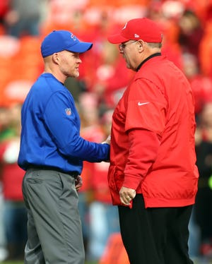 Chiefs coach Andy Reid, right, speaks with Bills head coach Sean McDermott before a game. McDermott, who was fired by Reid as defensive coordinator for the Eagles in 2011, will bring his team to Arrowhead Stadium Sunday for the AFC Championship.