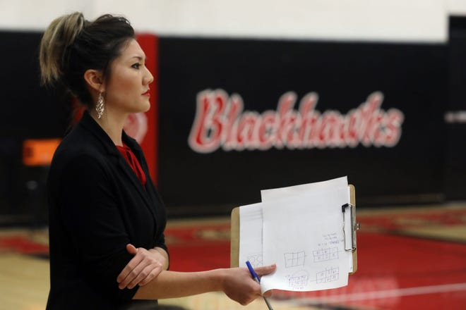 Southeastern Community College's head coach Micki Glass watches from the sidelines while playing DMACC, Wednesday Oct. 9, 2019 at SCC's Loren Walker Arena.