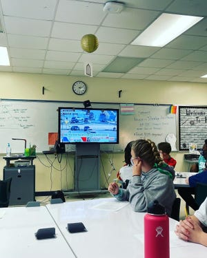 Sixth-graders in Ali Knoll's James Weldon Johnson College Preparatory Middle School class watch the presidential inauguration in class.