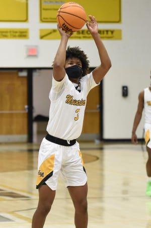 Kings Mountain's Isaiah Tate shoots a free throw during last week's game against Ashbrook. [GARY SMART/Special to The Star]