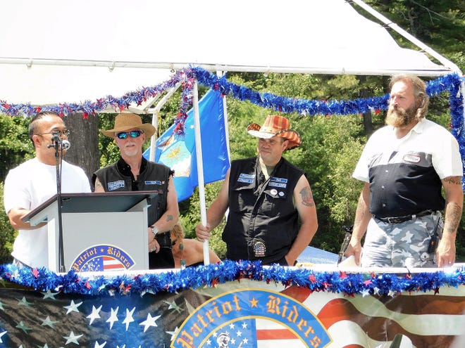 State Sen. Dean Tran speaks during the 2019 American Day in the Park event in Gardner. From left are Tran, Patriot Riders of America Chapter 3 Vice President Jack McGrath, President Neil Goguen and Patriot Rider Mike Enright.