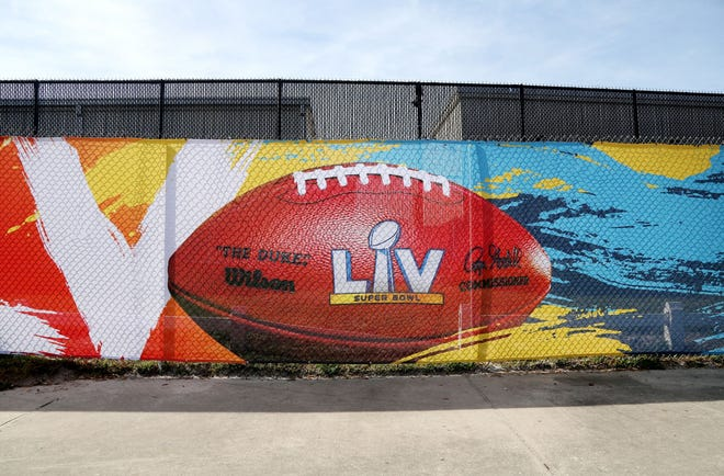 A Super Bowl 55 sign adorns a privacy fence outside of Raymond James Stadium on  Wednesday in Tampa.