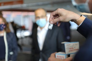 At Gillette Stadium in Foxboro on Thursday, Jan. 21, the Baker-Polito Administration outlined plans to start vaccines for congregate care settings, the next priority group within Phase One of the Commonwealth's COVID-19 vaccine distribution plan. A vial of the Moderna vaccine is displayed here at the Gillette event.