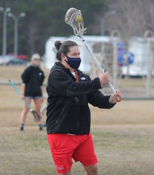 Northside lacrosse coach Logan Sullivan passes the ball to a player during a practice. Sullivan is a 2016 Jacksonville graduate and was a standout player for the Cardinals. [Chris Miller / The Daily News]