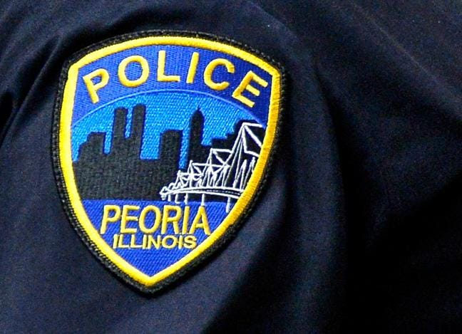 A Peoria police badge is shown in a file photo