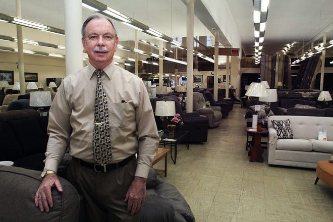Cal Wescott stands in the showroom of Rite-Way Furniture & Appliance on Wednesday, Jan. 20, 2021, in downtown Freeport. He's celebrating 30 years in business.