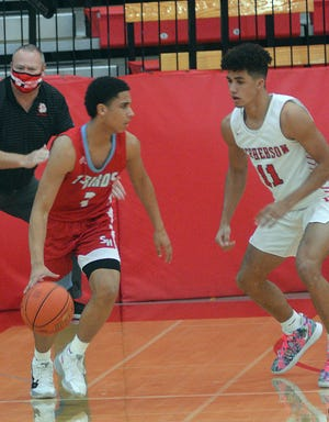 Shawnee Heights' Isaih Johnson scored 22 points in a 60-54 overtime win over McPherson at the McPherson Invitational. Shawnee Heights takes on Manhattan Saturday.