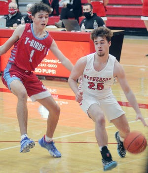 McPherson's Jayton Alexander drives by Shawnee Heights during play in the McPherson Invitational.