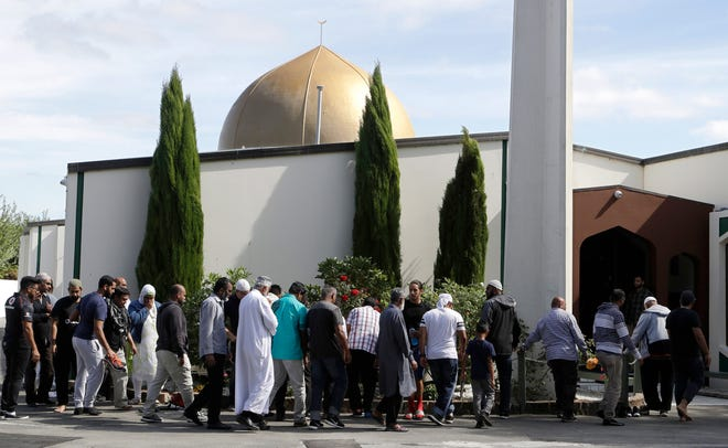 In this March 23, 2019 file photo, worshippers prepare to enter the Al Noor mosque following the previous week's mass shooting in Christchurch, New Zealand.