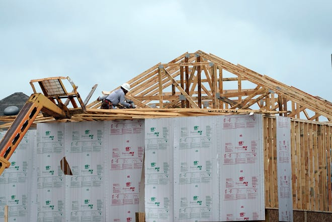 This Sept. 24, 2020 file photo shows a new home under construction in Houston.  The number of newly issued permits to build fresh housing rose 6.2% in November on a seasonally adjusted basis.