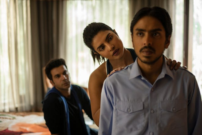 """This image released by Netflix shows Rajkummar Rao, from left, Priyanka Chopra and Adarsh Gourav in a scene from """"The White Tiger."""""""