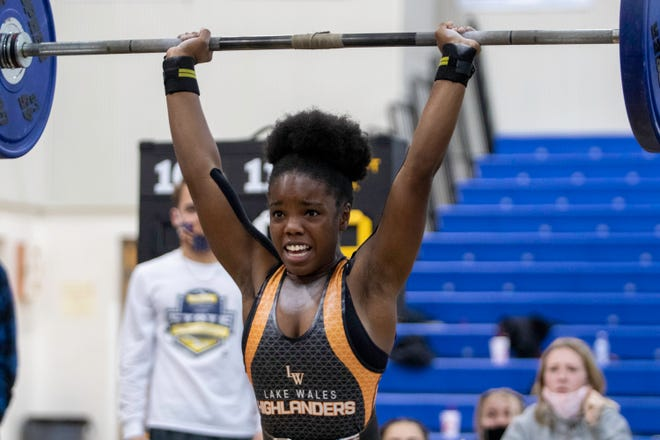 Lake Wales senior Kyra Battles completes her final lift of 140 pounds to win the 110-pound division with a 270-pound total on Thursday afternoon at the Class 2A, District 12 girls weightlifting meet at Harmony High School.