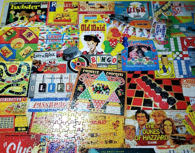 Board game box tops provide the theme for this puzzle, completed by Robin and her husband John.