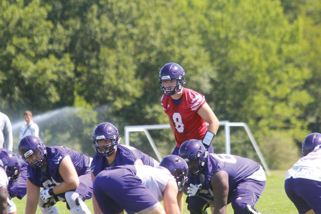 Western Illinois quarterback Connor Sampson calls a play on the first day of practice during the 2019 season.