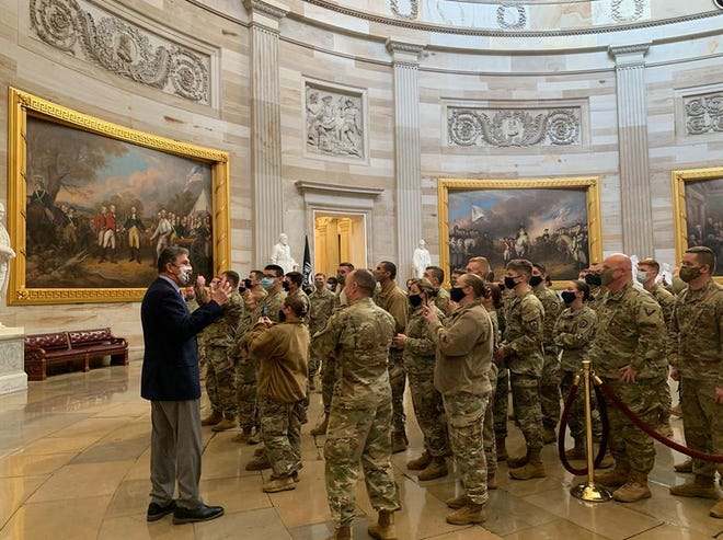 """Sen. Joe Manchin gives members of the West Virginia National Guard a tour of the Capitol. The guard was deployed to Washington, D.C. last weekend to assist with security for Inauguration Week. """"I am incredibly proud of these West Virginia sons and daughters and I encourage my fellow West Virginians to thank our troops for representing the Mountain State here in Washington during these difficult times and wish them a safe return home,"""" Manchin said."""