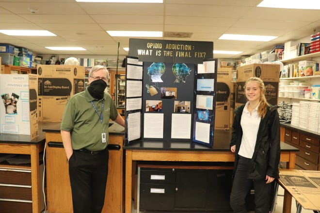 """Mori McCain, a 10th-grade student at Rocky Bayou Christian School, presents her science fair project, """"Opioid Addiction: What is the final fix?"""""""