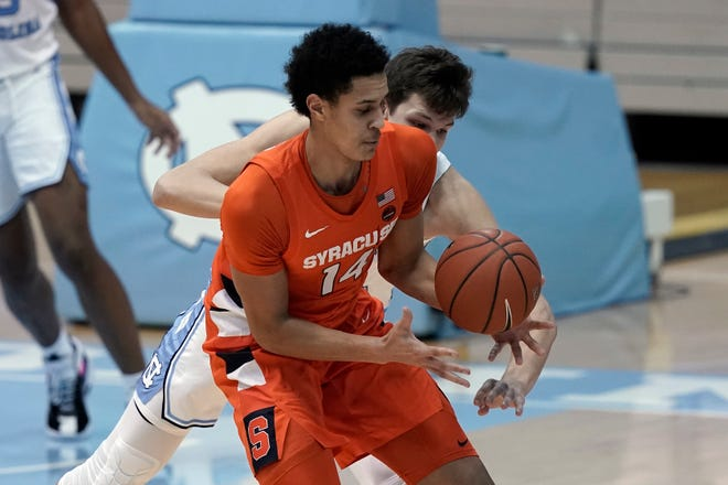 Syracuse center Jesse Edwards' looming presence — his arms when outstretched extend 7 feet, 4 inches – has helped the team recently.