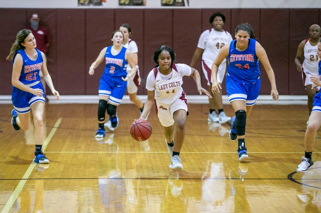 North Marion's Erianna Williams takes the ball and runs down the court. North Marion defeated Keystone Heights, 48-42.