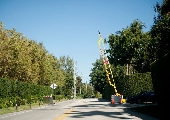 A boom barrier is seen Friday on South Ocean Boulevard at Blossom Way south of the Mar-a-Lago Club. MEGHAN McCARTHY / PALM BEACH DAILY NEWS