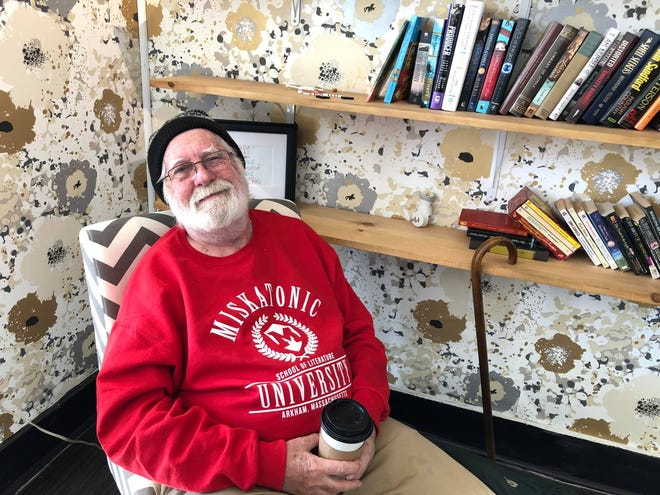"""Sweet Blis Cafe regular Garry Curtis relaxes with a cup of coffee in Petersburg on Jan. 19, 2021. """"Garry hasn't missed a day since we've been open,"""" said owner Amy Crump."""