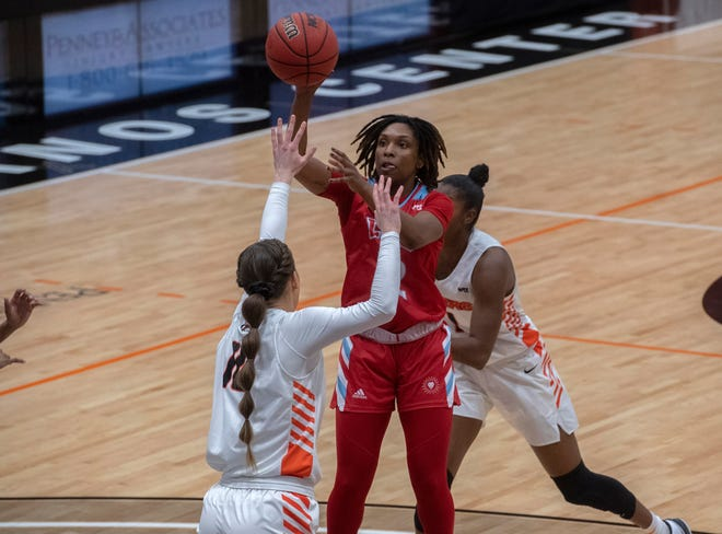 LMU's Ariel Johnson, right, shoots over Pacific's Savannah Whitehead during a WCC women's basketball game Jan. 21 at Pacific's Spanos Center in Stockton.