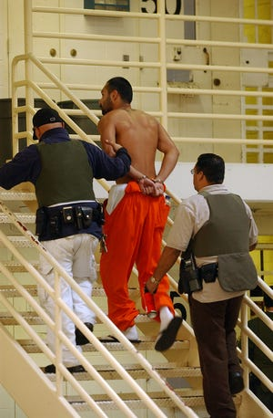 A ward is escorted back to his cell at Chaderjian Youth Correctional Facility in Stockton in 2006. The state said in September that it was phasing out its state-operated juvenile prison system; two of the state's youth prisons are in Stockton.