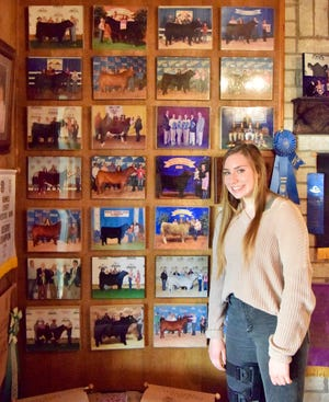 Allie Kalina continues a family tradition of raising and showing animals at livestock shows across the state. The awards of her and her 2 sisters fill 2 walls.