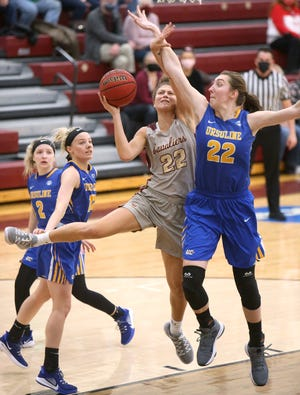 Mayci Sales (left) of Walsh goes to the basket but gets tangled up with with Katrina Scheuvront (right) of Ursuline during their game at Walsh on Thursday, Jan. 21, 2021.