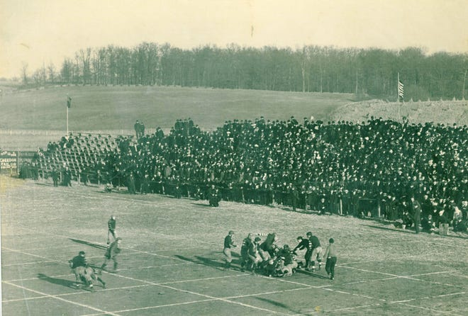 """Action from when Canton and Massillon played in 1906 displays how a pro football field was marked off in a 5-yard by 5-yard grid to assist game officials with the rules in place then. Historians believe that the term """"gridiron"""" was a result."""