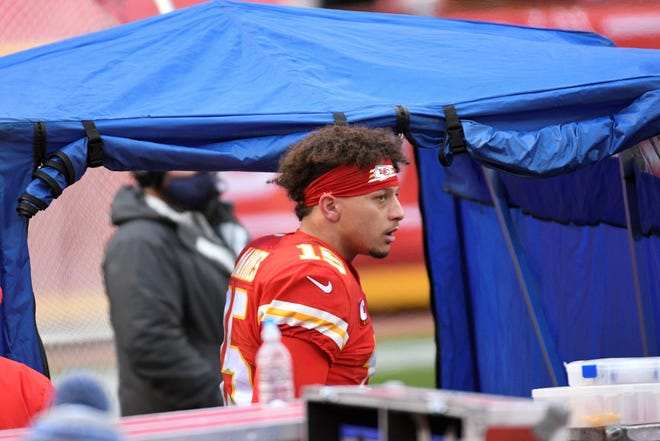 Kansas City Chiefs quarterback Patrick Mahomes enters the injury tent during the second half of last Sunday's playoff game against the Cleveland Browns. Mahomes has been cleared to play in the AFC championship game this Sunday against the Buffalo Bills.
