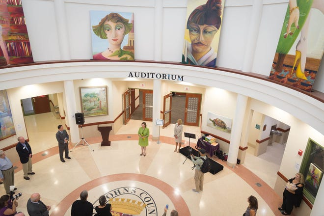 Renowned artist and county resident Susanne Schuenke, center, speaks in the rotunda of the St. Johns County Administration building during an opening reception for a show of her paintings in 2017.