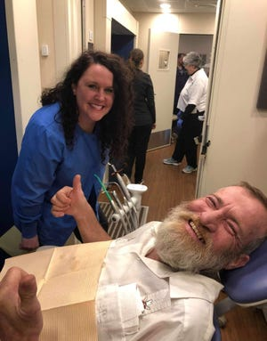 A patient gives the thumbs-up during a visit to the free dental clinic Pleasant City Church held in 2020. The church is taking applications for this year's clinic.