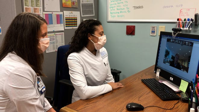 Sarasota Memorial Hospital nurses attend a Zoom conference call with NFL Commissioner Roger Goodell.