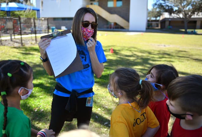 Fruitville Elementary kindergarten teacher Kari Johnson talks to her students before they start a fundraising jog-a-thon Friday afternoon at the school. Johnson was named Sarasota County's 2020-21 Teacher of the Year on Thursday evening.