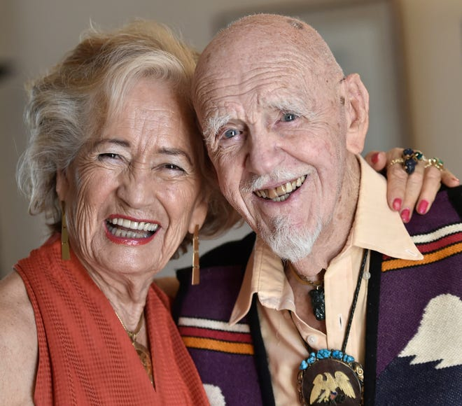 Dr. John Manhold with his wife, Kit. John Manhold, 101, has been reviewing hundreds of books on Amazon for the past few years. The retired dentist/pathologist/professor has had to slow down – from two books a week to one – as he is now writing a memoir of his remarkable life.